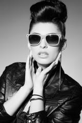 beautiful punk woman model wearing sun glasses and