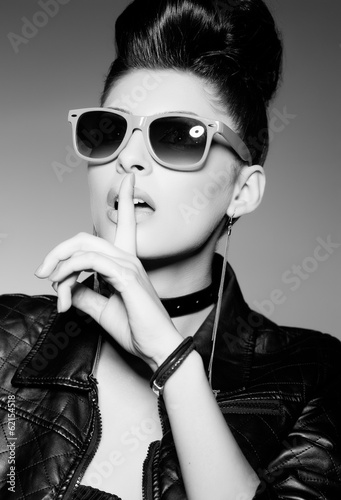 beautiful punk woman model wearing sun glasses