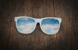 sunglasses on wood  background
