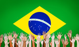 Multi-Ethnic Hands With Flag Of Brazil For The Background