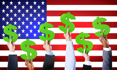 Business Hands Holding Dollar Signs With American Flag