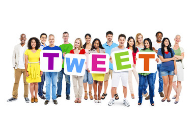 "Group of Multiethnic World People Holding ""TWEET"""