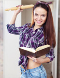 Woman reads book for recipe