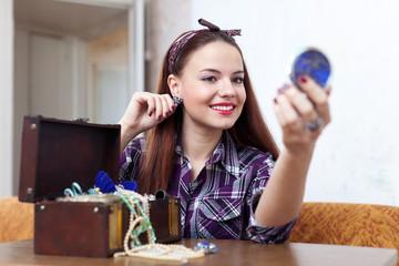 housewife tries earrings in home