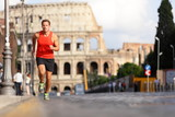 Running runner man by Colosseum, Rome, Italy