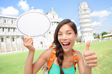 Travel tourist girl showing sign in Pisa, Italy