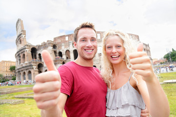 Happy travel couple in Rome by Coliseum in love