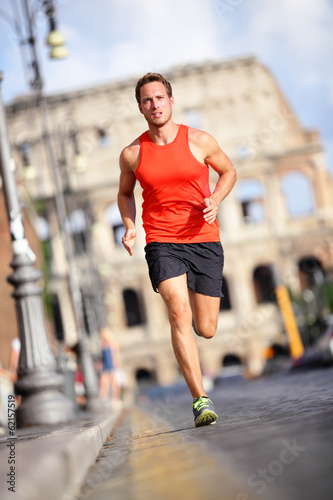 Runner - man running by Colosseum, Rome, Italy