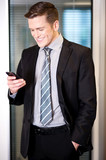Businessman sending text message