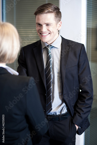 Relaxed managers communicating cheerfully