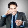 Portrait of a young businessman gesturing call me sign