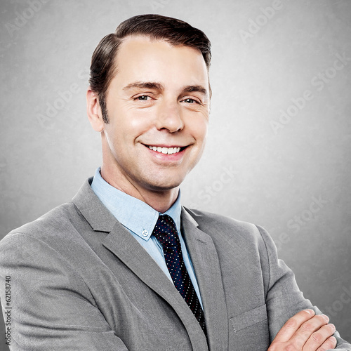 Handsome business executive smiling at the camera