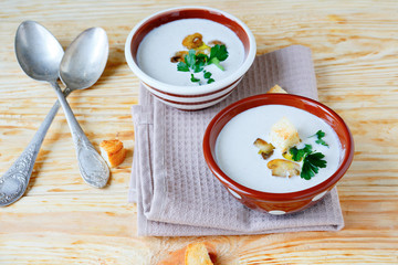 two bowls of fragrant mushroom soup