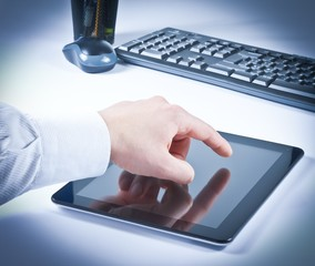 businessman hand touch tablet pc in the office