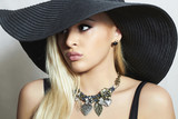 Beautiful Blond Woman in Black Hat.Beauty Girl.Spring.Jewelry