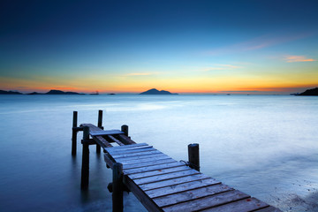 Wooden jetty with sunset