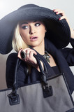 Beautiful Blond Woman in Hat.Beauty Girl with Handbag.Shopping