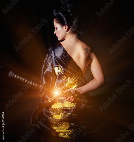Woman with japan sword katana in hands