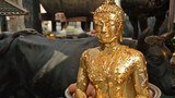 buddha statue with gold leaves