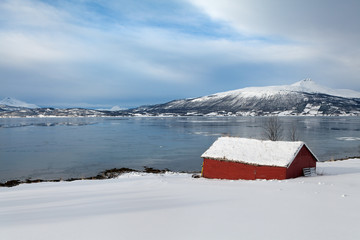 Red wooden cabin in northern Norway
