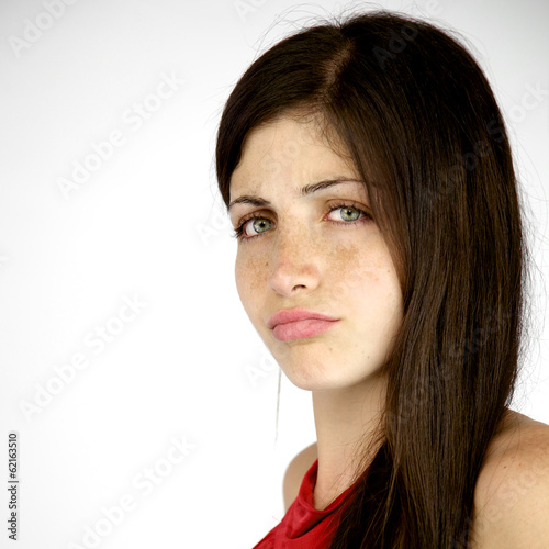 Unhappy shy woman with freckles