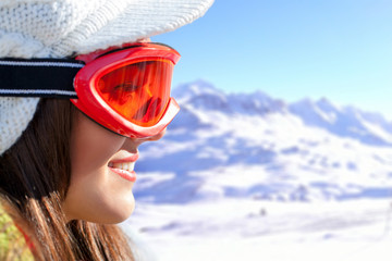 Face shot of female skier with snow glasses.