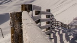 Snow covered fence Tirol time lapse close up