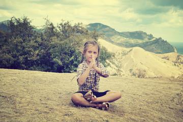 little girl meditates