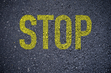 stop word painted on asphalt