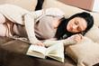 Young woman had fallen asleep while reading a book