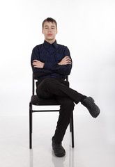 teenager sitting on a chair