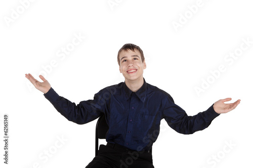 Happy teenager on white background looking up