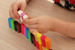 child play with colorful plasticine blocks