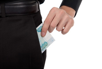 man's hand puts money into the pocket of the ruble