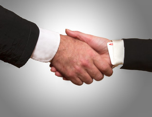 Woman hand with ace up the sleeve hand shake with man