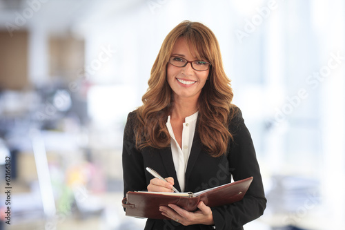 Professional businesswoman standing in office