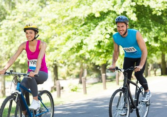 Happy cyclists riding bicycles
