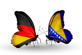 Two butterflies with flags Germany and Bosnia and Herzegovina