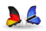 Two butterflies with flags Germany and Botswana