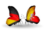 Two butterflies with flags Germany and Bhutan