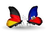 Two butterflies with flags Germany and Haiti