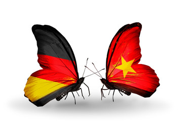 Two butterflies with flags Germany and Vietnam