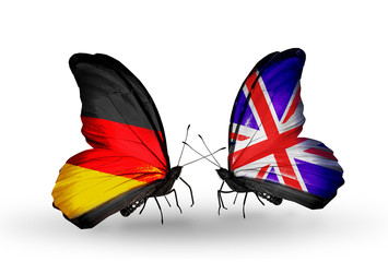 Two butterflies with flags Germany and UK