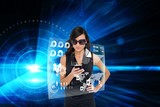 Glamorous brunette using smartphone with interface