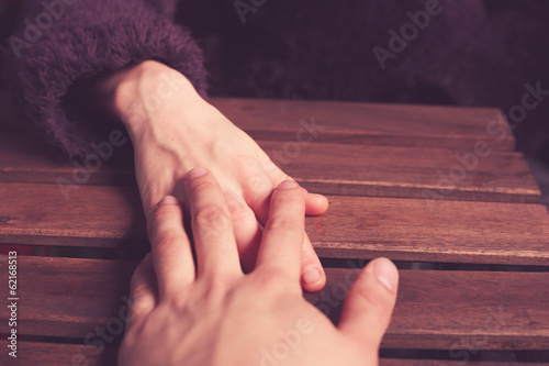 Couple's hands at table