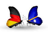 Two butterflies with flags Germany and Nauru