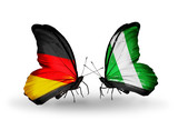 Two butterflies with flags Germany and Nigeria