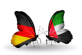 Two butterflies with flags Germany and UAE