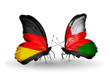 Two butterflies with flags Germany and Oman