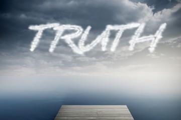 Truth against cloudy sky over ocean